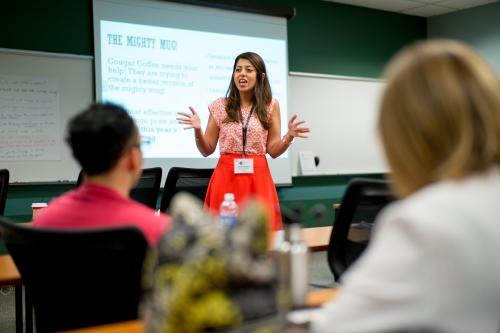A woman presents at the UTeach Conference